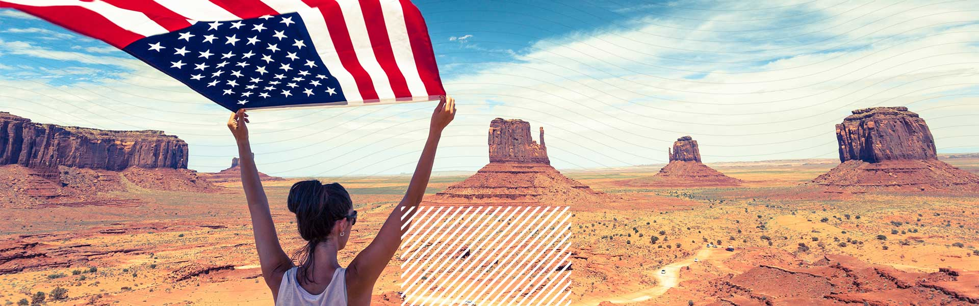 woman holding usa flag in desert