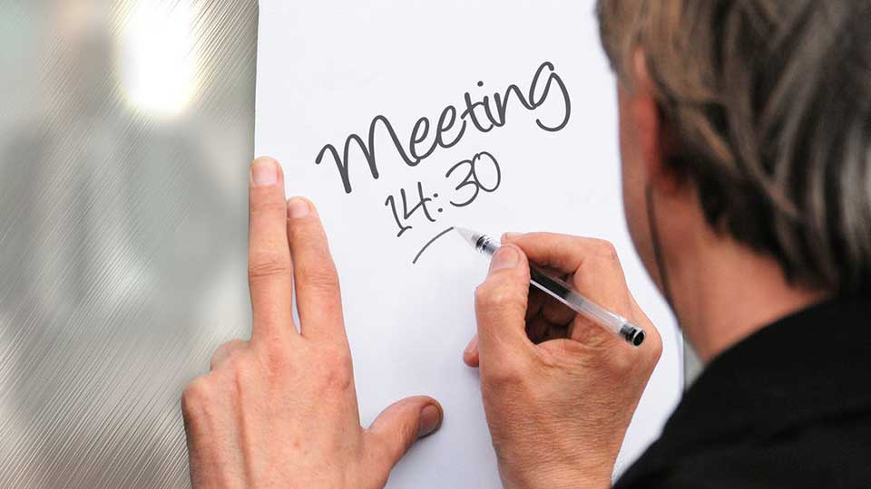 man writting meeting