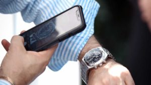 man taking picture of his watch