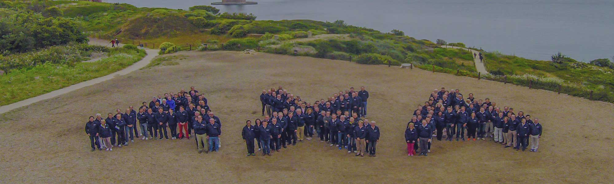 people forming axa logo in SF
