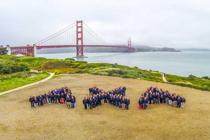 people forming axa logo in SF