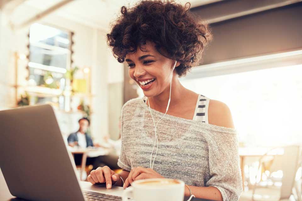woman having meeting on laptop