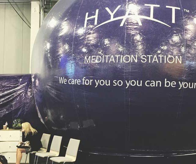 Women at meditation station at trade show