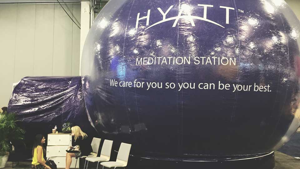 Women at meditation station at trade show