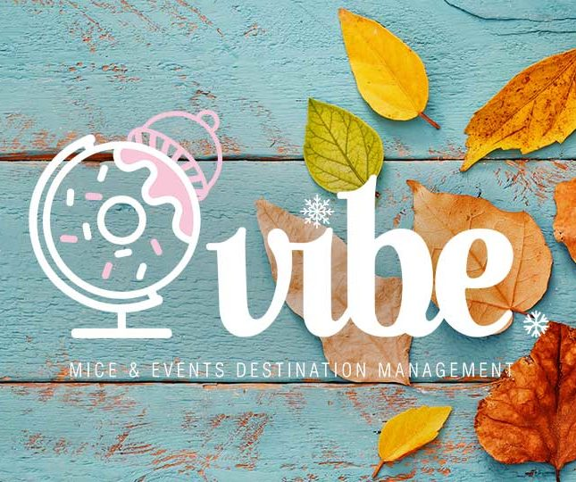 leaves on blue wood with vibe logo