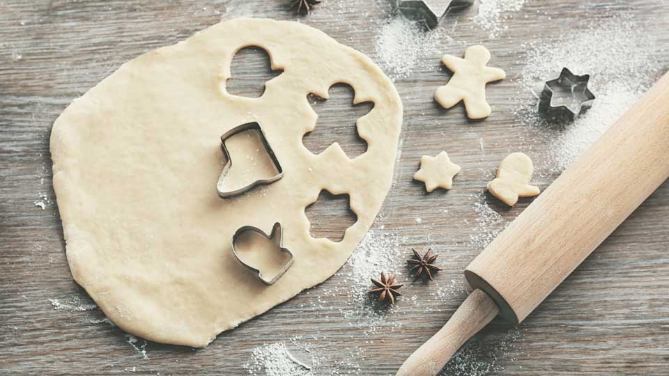 Wooden cutting board with cookie dough