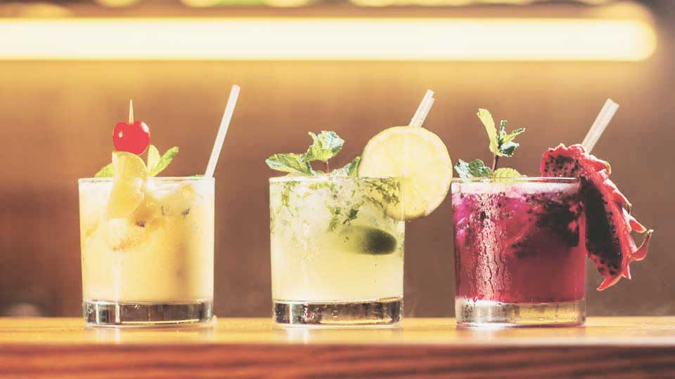Description: Cocktails lined up on a table