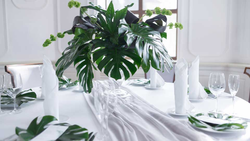 Wedding served table setting of palm tree leaves