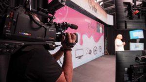 1. Cameraman focusing on VIBE's president, Valerie Bihet on stage