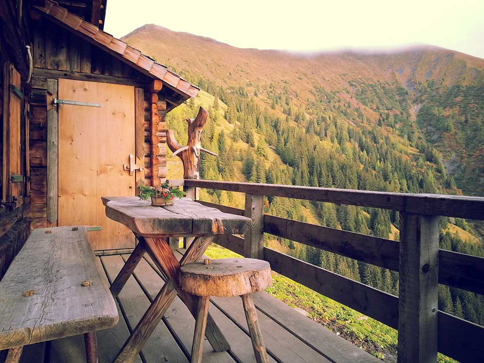 2. brown wooden table and bench overlooking mountains