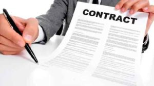 hand holding a contract