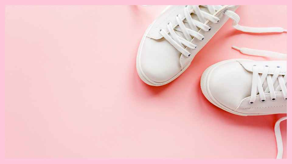 white shoes on pink background